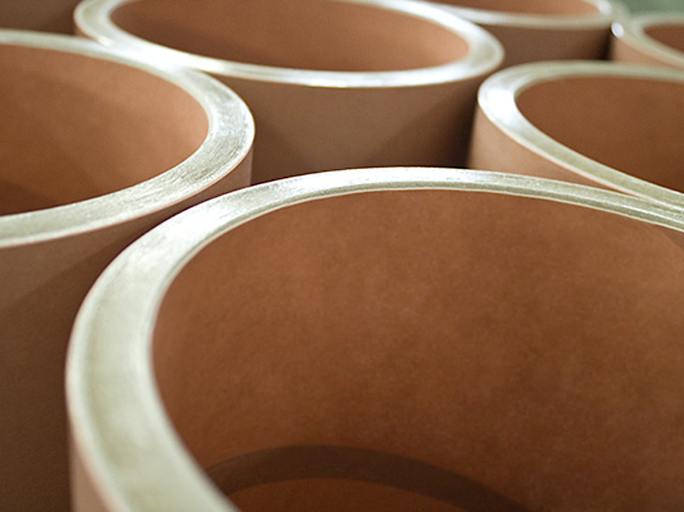 Paper cores for films and foils and flexible packaging